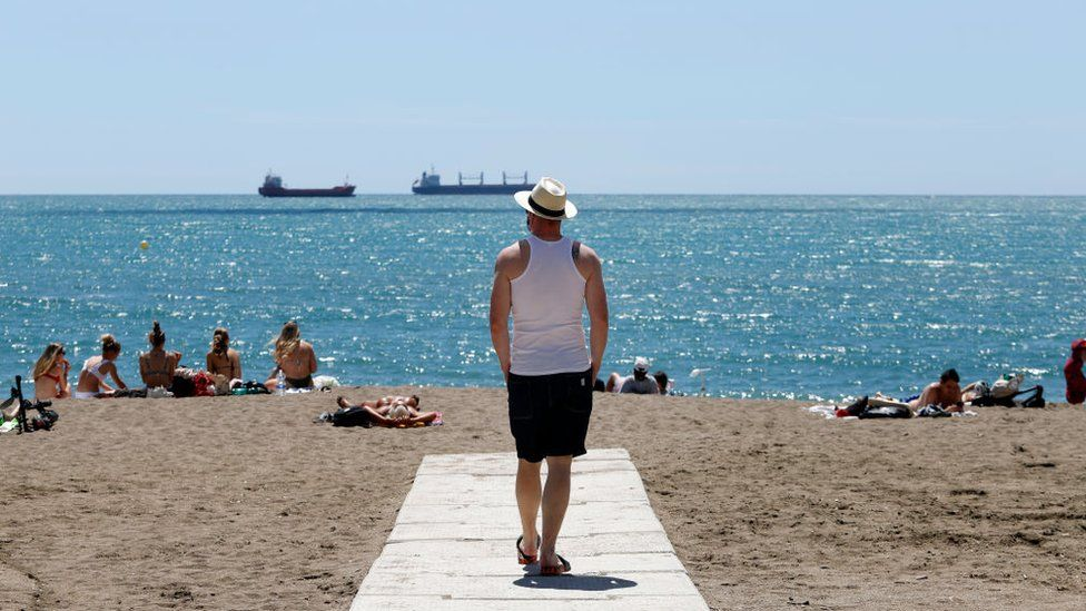Visitors enjoy the beaches in Malaga, Spain