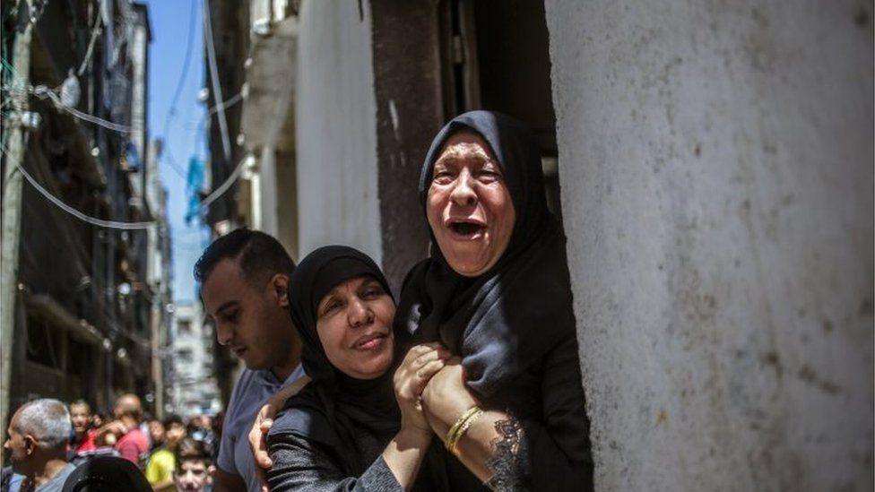 Grandmother of 15-year-old Mahmud Tolba, who was killed in Israeli air strike, mourns during his funeral in Al Zaitun neighbourhood in the east of Gaza City