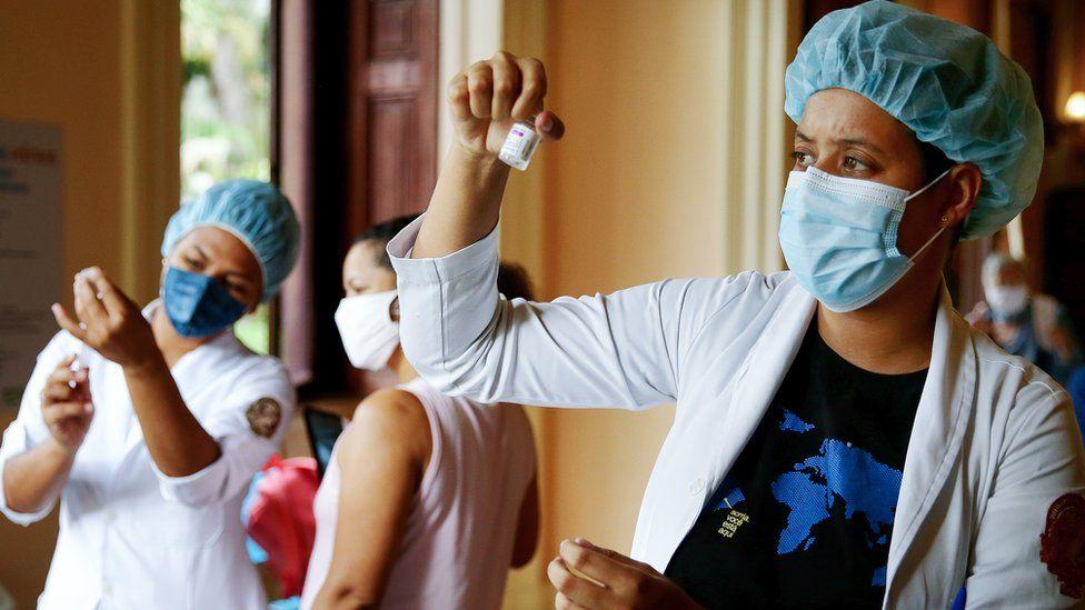 Nurse-in-training Julia Ramos prepares to vaccinate a person at a Covid-19 vaccination clinic at Museu da Republica in Rio de Janeiro