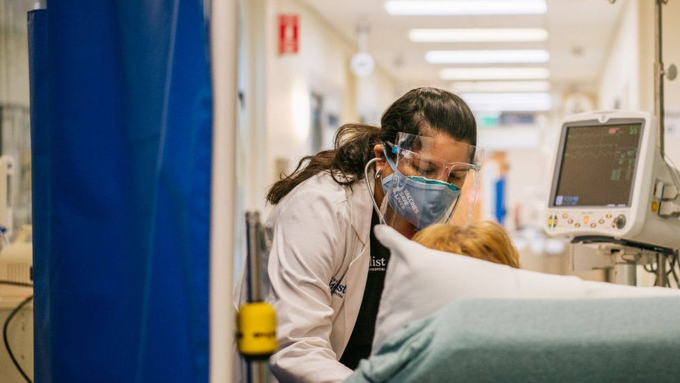 An Emergency Room nurse tends to a patient in a hallway at the Houston Methodist The Woodlands Hospital on August 18, 2021 in Houston, Texas.