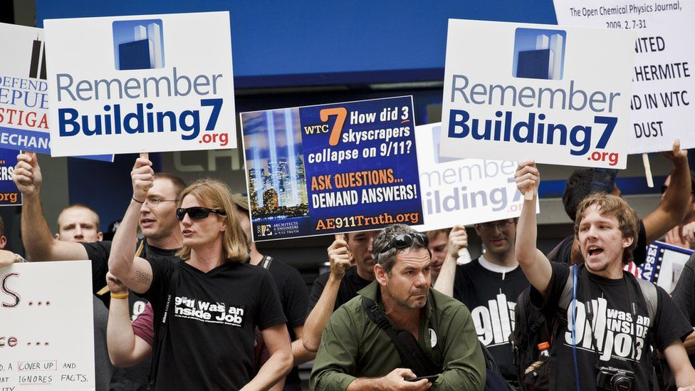 9/11 conspiracy theorists protest outside the memorial service at the World Trade Center construction site marking the 10th anniversary of the attacks on September 11, 2001.