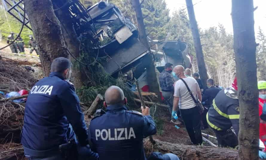 Police and rescue service members are seen near the crashed cable car after it collapsed in Stresa, near Lake Maggiore, Italy.