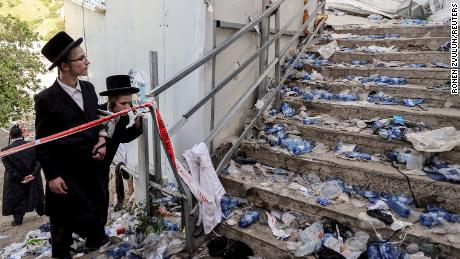 Ultra-Orthodox Jews on April 30, 2021 beside stairs on Mount Meron, northern Israel, where a religious festival was held.
