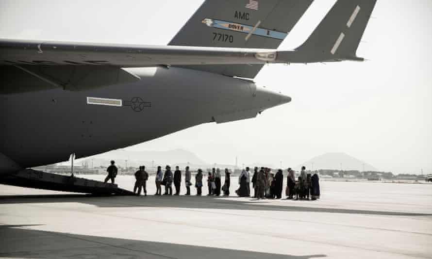 Evacuees wait to board a Boeing C-17 Globemaster III in Kabul on 30 August