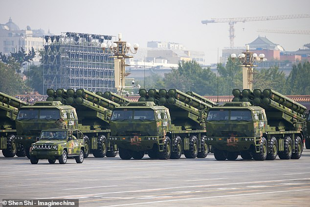 A group of almost 200 British academics from more than a dozen universities could face jail, as officials probe whether they may have unwittingly helped the Chinese government build weapons of mass destruction. Pictured: Library image showingA Dongfeng-41 intercontinental strategic nuclear missiles group formation
