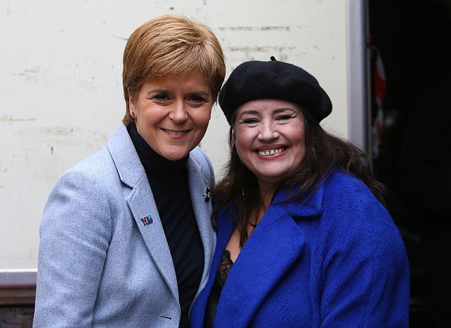 Jewish leaders and anti-Semitism campaigners last night urged the SNP to launch an investigation into 'unacceptable' comments by Glasgow candidate Suzanne McLaughlin (seen with Nicola Sturgeon)