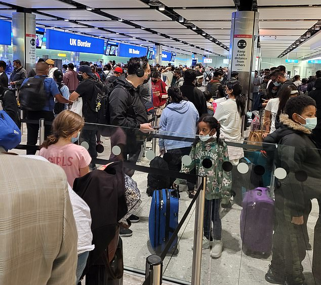 Passengers flying into the UK today faced 'bedlam' at the borders with some facing a three hour wait. Pictured: One arrival sent this picture in of the queues at Heathrow today