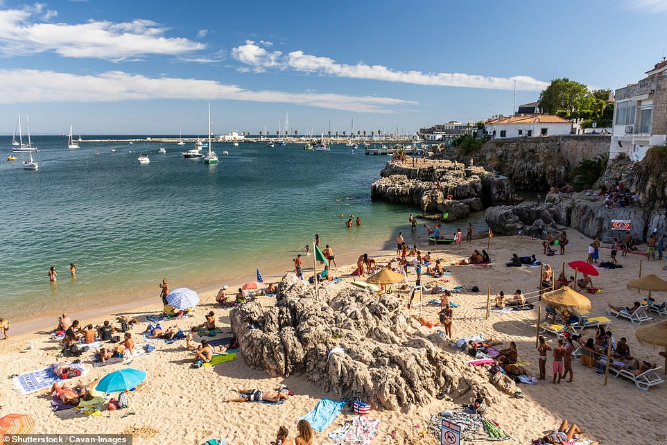 Portugal (pictured: A beach in Cascais near Lisbon) could be dropped from the UK's travel green list today - in a move that will be a bitter blow to millions of Britons hoping for a holiday abroad this summer