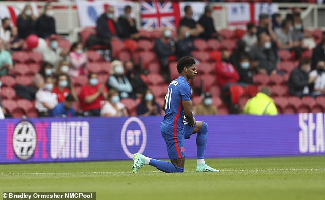 Supporters' groups said the political gesture ahead of kick off has now 'lost its original meaning' and 'is being misinterpreted'. Pictured: Marcus Rashford before the Romania game