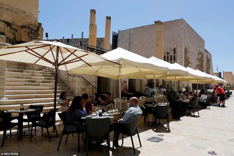 Ministers are under intense pressure to lift Covid travel restrictions on the Balearic islands and Malta today after scientists declared them safe. Pictured: The Maltese capital Valetta in May [File photo]