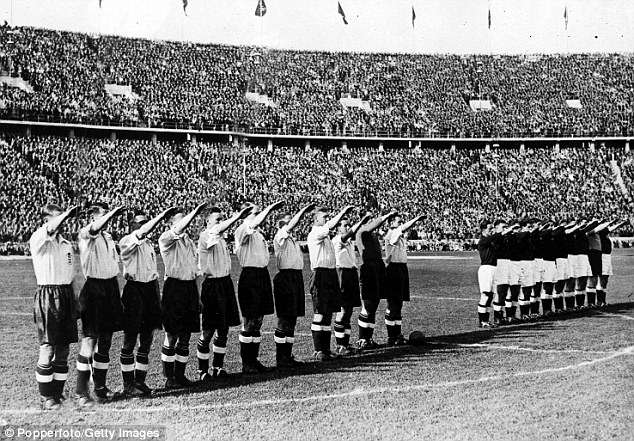 Brendan Clarke-Smith controversially invoked England's decision to perform a Nazi salute before a 1938 friendly with Germany (pictured) to demonstrate that 'mixing politics and football' has 'disastrous consequences'