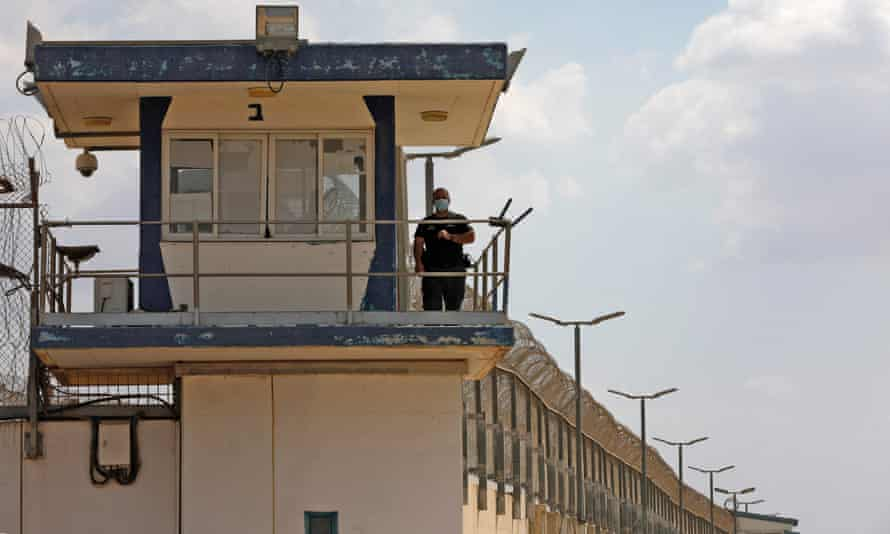 A police officer keeps watch from an observation tower at the Gilboa prison in northern Israel
