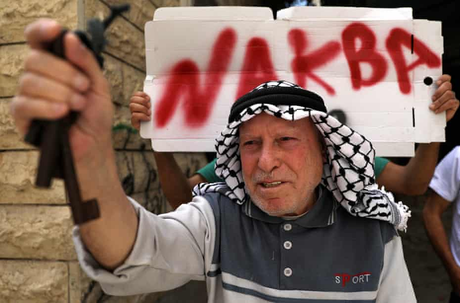 A Palestinian man marks the 72nd anniversary of Nakba in Hebron in May last year. The key symbolises the home he left behind in 1948.