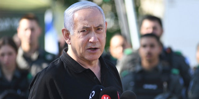 Israeli Prime Minister Benjamin Netanyahu meets with Israeli border police on Thursday, May 13, 2021 in Lod, near Tel Aviv after a wave of violence in the city the night before. (AP Photo/Yuval Chen, Yediot Ahronot, Pool)