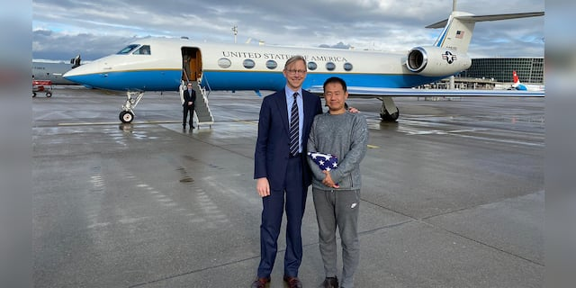 Xiyue Wang and Brian Hook, the U.S. State Department's Iran special enjoy after Wang's release from Iran prison.
