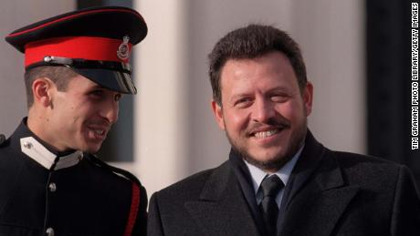 King Abdullah II (R) and then Crown Prince Hamzah at the Sandhurst military parade in 1999.