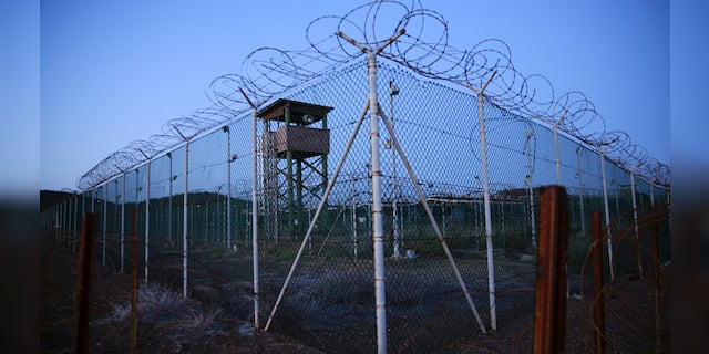 FILE PHOTO - Chain link fence and concertina wire surrounds a deserted guard tower within Joint Task Force Guantanamo's Camp Delta at the U.S. Naval Base in Guantanamo Bay, Cuba March 21, 2016. REUTERS/Lucas Jackson/File Photo