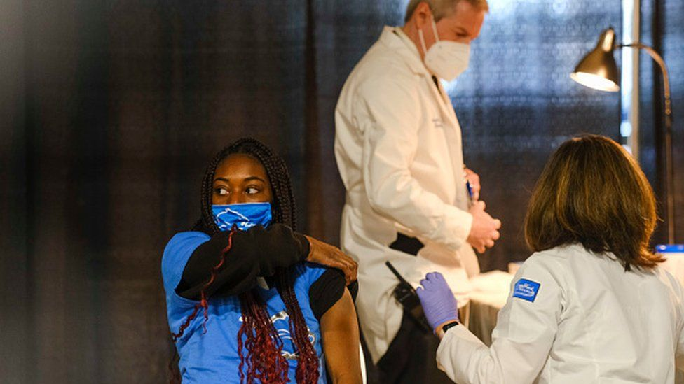 A group of teenagers serving as 'Covid-19 Student Ambassadors' joined Governor Gretchen Whitmer to receive a dose of the Pfizer Covid vaccine at Ford Field during an event to promote and encourage Michigan residents to go and get their vaccines on April 6, 2021 in Detroit, Michigan