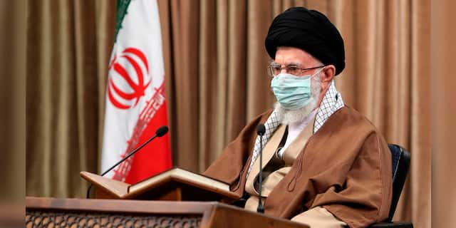In this picture released by an official website of the office of the Iranian supreme leader, Supreme Leader Ayatollah Ali Khamenei wearing a protective face mask, attends a meeting in Tehran, Iran, Wednesday, April 14, 2021. (Office of the Iranian Supreme Leader via AP)