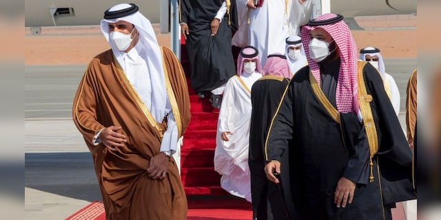 Saudi Arabia's Crown Prince Mohammed bin Salman, right, welcomes Qatar's Emir Sheikh Tamim bin Hamad al-Thani upon his arrival to attend the Gulf Cooperation Council's 41st Summit in Al-Ula, Saudi Arabia, Tuesday, Jan. 5, 2021. (Saudi Royal Court via AP)